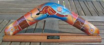 Aboriginal art corporate boomerangs with logo on stand